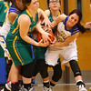 1-19-17<br /> Tri Central vs Eastern girls basketball<br /> Eastern's Maci Weeks, Lexi James, and TC's Taylor Davis go after the ball.<br /> Kelly Lafferty Gerber | Kokomo Tribune