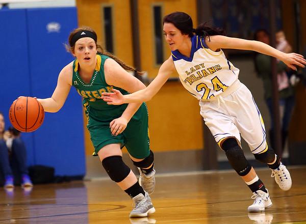 1-19-17<br /> Tri Central vs Eastern girls basketball<br /> Maci Weeks tries to keep the ball from TC's Taylor Davis.<br /> Kelly Lafferty Gerber   Kokomo Tribune
