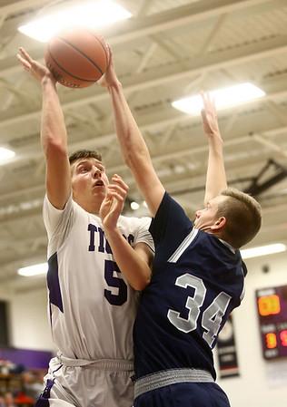 1-3-17<br /> Northwestern vs Central Catholic boys basketball<br /> NW's Jay Pike puts up a shot.<br /> Kelly Lafferty Gerber | Kokomo Tribune