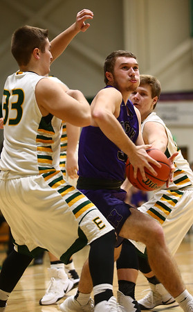 1-14-17<br /> Eastern vs Northwestern boys basketball<br /> NW's Noah Dowden muscles through Eastern's defense to the basket.<br /> Kelly Lafferty Gerber   Kokomo Tribune