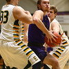 1-14-17<br /> Eastern vs Northwestern boys basketball<br /> NW's Noah Dowden muscles through Eastern's defense to the basket.<br /> Kelly Lafferty Gerber | Kokomo Tribune