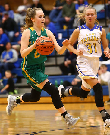 1-19-17<br /> Tri Central vs Eastern girls basketball<br /> Eastern's Kaylee Weeks dribbles down the court.<br /> Kelly Lafferty Gerber | Kokomo Tribune