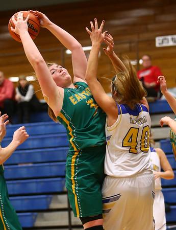 1-19-17<br /> Tri Central vs Eastern girls basketball<br /> Eastern's Hailey Holliday grabs a rebound.<br /> Kelly Lafferty Gerber | Kokomo Tribune