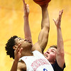 1-13-17<br /> Kokomo vs Harrison boys basketball<br /> Kokomo's Keenen Wheeler grabs the rebound.<br /> Kelly Lafferty Gerber | Kokomo Tribune