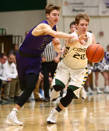 1-14-17<br /> Eastern vs Northwestern boys basketball<br /> NW's Collin Hodson looks to steal the ball from Eastern's Draeden Morris-Graber.<br /> Kelly Lafferty Gerber | Kokomo Tribune