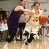 1-14-17<br /> Eastern vs Northwestern boys basketball<br /> NW's Collin Hodson looks to steal the ball from Eastern's Draeden Morris-Graber.<br /> Kelly Lafferty Gerber | Kokomo Tribune