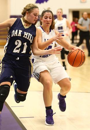 1-11-17<br /> Northwestern vs Oak Hill girls basketball<br /> NW's Sophia Beachy keeps the ball from Oak Hill's Jenessa Hasty.<br /> Kelly Lafferty Gerber | Kokomo Tribune