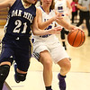 1-11-17<br /> Northwestern vs Oak Hill girls basketball<br /> NW's Sophia Beachy keeps the ball from Oak Hill's Jenessa Hasty.<br /> Kelly Lafferty Gerber | Kokomo Tribune