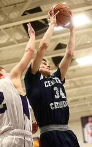 1-3-17 Northwestern vs Central Catholic boys basketball CC's Carson Barrett grabs a rebound. Kelly Lafferty Gerber | Kokomo Tribune