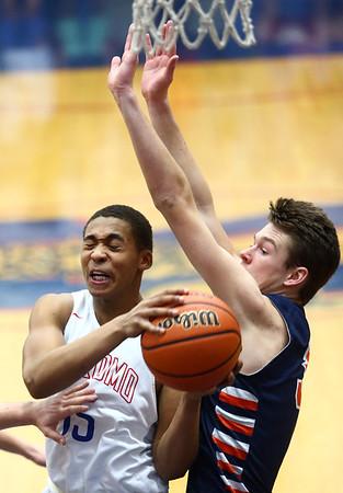 1-13-17<br /> Kokomo vs Harrison boys basketball<br /> Kokomo's Elonte O'Bannon tries to get around Harrison's defense as he goes to the basket.<br /> Kelly Lafferty Gerber | Kokomo Tribune