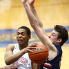 1-13-17<br /> Kokomo vs Harrison boys basketball<br /> Kokomo's Elonte O'Bannon tries to get around Harrison's defense as he goes to the basket.<br /> Kelly Lafferty Gerber | Kokomo Tribune