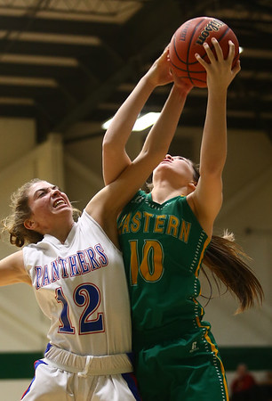 1-31-17<br /> Eastern vs Elwood girls basketball<br /> Eastern's Allison Hanner and Elwood's Brookelyn Creamer go up for a rebound.<br /> Kelly Lafferty Gerber | Kokomo Tribune