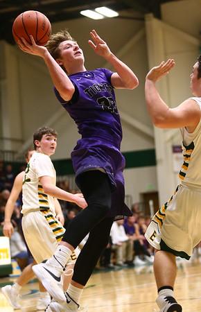 1-14-17<br /> Eastern vs Northwestern boys basketball<br /> NW's Peyton Hawk shoots.<br /> Kelly Lafferty Gerber | Kokomo Tribune