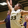 1-14-17<br /> Eastern vs Northwestern boys basketball<br /> NW's Eli Dubbels and Eastern's Luke Monize go after a rebound.<br /> Kelly Lafferty Gerber | Kokomo Tribune