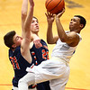 1-13-17<br /> Kokomo vs Harrison boys basketball<br /> Kokomo's Trajan Deckard goes up for a shot.<br /> Kelly Lafferty Gerber | Kokomo Tribune
