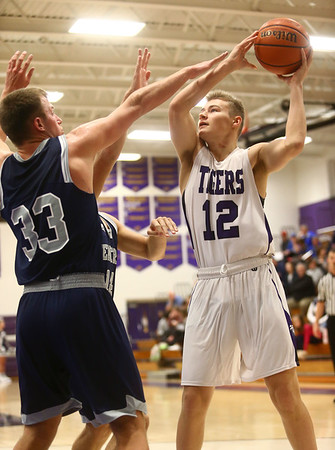 1-3-17<br /> Northwestern vs Central Catholic boys basketball<br /> NW's T.J. Macaluso shoots.<br /> Kelly Lafferty Gerber | Kokomo Tribune