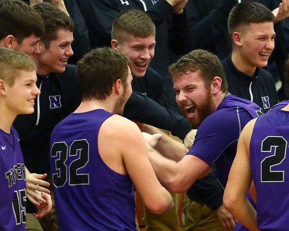 1-20-17<br /> Cass vs Northwestern boys basketball<br /> NW's Trey Richmond celebrates with teammates as the seconds count down before NW's win over Cass.<br /> Kelly Lafferty Gerber | Kokomo Tribune