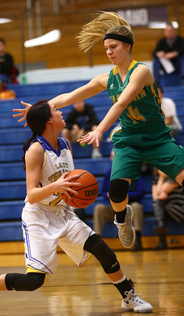 1-19-17<br /> Tri Central vs Eastern girls basketball<br /> TC's Taylor Davis looks to the basket as Eastern's Cassie Williams tries to block her.<br /> Kelly Lafferty Gerber | Kokomo Tribune