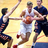 1-13-17<br /> Kokomo vs Harrison boys basketball<br /> Kokomo's Anthony Barnard tries to break through Harrison's defense to get to the basket.<br /> Kelly Lafferty Gerber | Kokomo Tribune