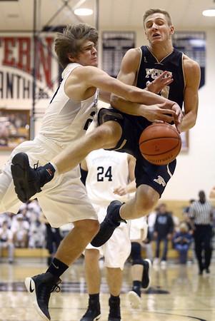 1-27-17<br /> Western vs Peru boys basketball<br /> Western's Ashton Guyer fouls Peru's Jonah Lester as Lester goes up for a shot.<br /> Kelly Lafferty Gerber | Kokomo Tribune