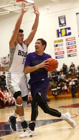 1-20-17<br /> Cass vs Northwestern boys basketball<br /> NW's Tyler Foster heads to the basket.<br /> Kelly Lafferty Gerber | Kokomo Tribune