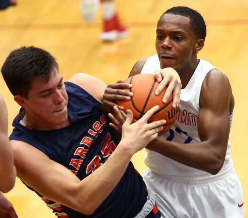 1-13-17<br /> Kokomo vs Harrison boys basketball<br /> Kokomo's Brevin Beard and Harrison's Benito Munoz go after the ball.<br /> Kelly Lafferty Gerber | Kokomo Tribune