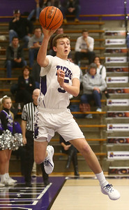 1-3-17 Northwestern vs Central Catholic boys basketball NW's Jay Pike passes the ball before going out of bounds. Kelly Lafferty Gerber | Kokomo Tribune