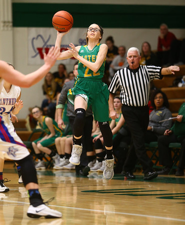 1-31-17<br /> Eastern vs Elwood girls basketball<br /> Eastern's Lexi James launches the ball from mid court to Hailey Holliday who scores during the last second of the first quarter.<br /> Kelly Lafferty Gerber   Kokomo Tribune