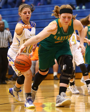 1-19-17<br /> Tri Central vs Eastern girls basketball<br /> Eastern's Hailey Holliday dribbles around TC's defense.<br /> Kelly Lafferty Gerber | Kokomo Tribune