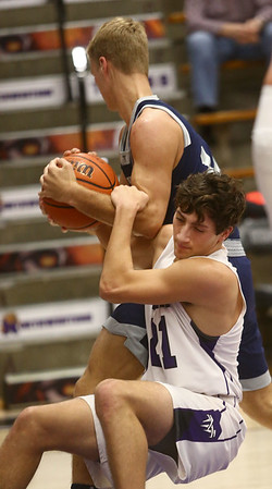 1-3-17 Northwestern vs Central Catholic boys basketball NW's Thomas Crocker tries to grab the ball from a CC player. Kelly Lafferty Gerber | Kokomo Tribune