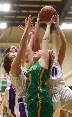 1-31-17<br /> Eastern vs Elwood girls basketball<br /> Eastern's Kaylee Weeks goes up for a rebound with a group of Elwood players.<br /> Kelly Lafferty Gerber   Kokomo Tribune