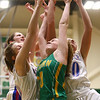 1-31-17<br /> Eastern vs Elwood girls basketball<br /> Eastern's Kaylee Weeks goes up for a rebound with a group of Elwood players.<br /> Kelly Lafferty Gerber | Kokomo Tribune