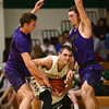 1-14-17<br /> Eastern vs Northwestern boys basketball<br /> Eastern's Zach Robinson looks to get around NW's Jay Pike and Noah Dowden.<br /> Kelly Lafferty Gerber | Kokomo Tribune