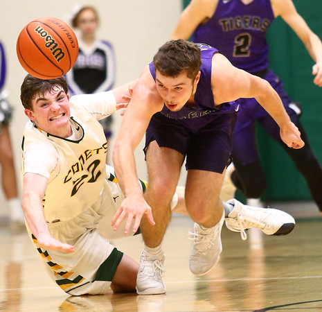 1-14-17<br /> Eastern vs Northwestern boys basketball<br /> Eastern's Ethan Henry and NW's Noah Dowden go after a loose ball.<br /> Kelly Lafferty Gerber | Kokomo Tribune