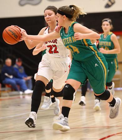 1-7-17<br /> Eastern vs Taylor girls basketball<br /> Eastern's Jeanie Crabtree knocks the ball away from Taylor's Austyn Huffer.<br /> Kelly Lafferty Gerber | Kokomo Tribune