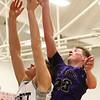 1-20-17<br /> Cass vs Northwestern boys basketball<br /> Cass' 51 and NW's Peyton Hawk go after a rebound.<br /> Kelly Lafferty Gerber | Kokomo Tribune