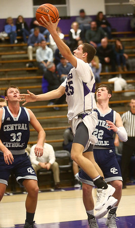 1-3-17<br /> Northwestern vs Central Catholic boys basketball<br /> NW's Tyler Foster puts up a shot.<br /> Kelly Lafferty Gerber | Kokomo Tribune