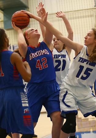 1-17-17<br /> Tipton vs Kokomo girls basketball<br /> Kokomo's Madison Wood looks to shoot over Tipton's defense.<br /> Kelly Lafferty Gerber | Kokomo Tribune
