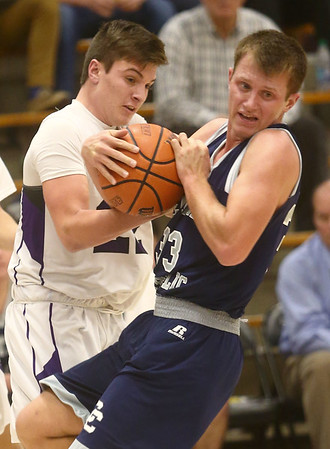 1-3-17<br /> Northwestern vs Central Catholic boys basketball<br /> CC's Jonah Switzer and NW's Eli Dubbels both go after the ball.<br /> Kelly Lafferty Gerber | Kokomo Tribune