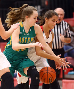 1-7-17 Eastern vs Taylor girls basketball Eastern's Kaylee Weeks and Taylor's Alison Pemberton go after a loose ball. Kelly Lafferty Gerber | Kokomo Tribune
