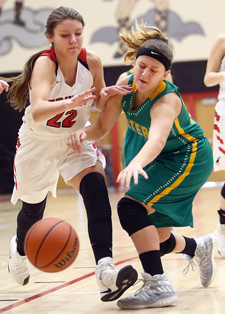 1-7-17 Eastern vs Taylor girls basketball Taylor's Austyn Huffer and Eastern's Jeanie Crabtree go after a loose ball. Kelly Lafferty Gerber | Kokomo Tribune