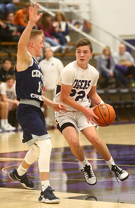 1-3-17 Northwestern vs Central Catholic boys basketball NW's Eli Dubbels looks down the court for a pass. Kelly Lafferty Gerber | Kokomo Tribune