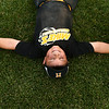 6-16-17<br /> Howard County Minor League Youth Baseball tournament championship<br /> Seth Parvin does a snow angel in the grass after Mike's Italian Grill defeats Fast Lane Foods.<br /> Kelly Lafferty Gerber | Kokomo Tribune