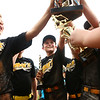 6-16-17<br /> Howard County Minor League Youth Baseball tournament championship<br /> Brody Hobson, center, celebrates with Mike's Italian Grill teammates after receiving the trophy.<br /> Kelly Lafferty Gerber | Kokomo Tribune