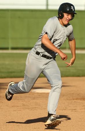 6-21-17<br /> Post 6 baseball<br /> Zach White runs to third after hitting a triple.<br /> Kelly Lafferty Gerber | Kokomo Tribune
