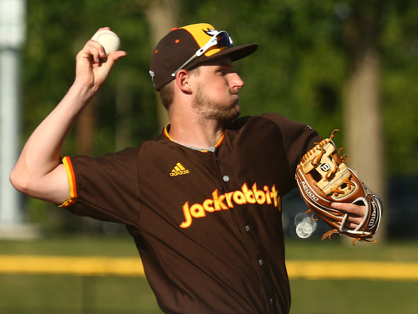 6-6-17<br /> Jackrabbits vs Aviators<br /> Mitchell Austin throws to first.<br /> Kelly Lafferty Gerber | Kokomo Tribune