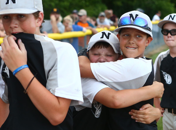 6-22-17<br /> Expressions beats Hollingsworth Lumber in the Kasey tournament championship <br /> Dylan Brehm hugs Alec Fourez after the game.<br /> Kelly Lafferty Gerber | Kokomo Tribune