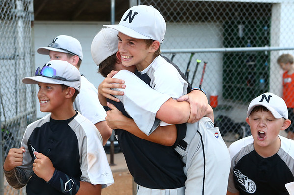 6-22-17<br /> Expressions beats Hollingsworth Lumber in the Kasey tournament championship <br /> Kai Jackson (right) gets a hug from teammate Tyson Good after the win.<br /> Kelly Lafferty Gerber | Kokomo Tribune