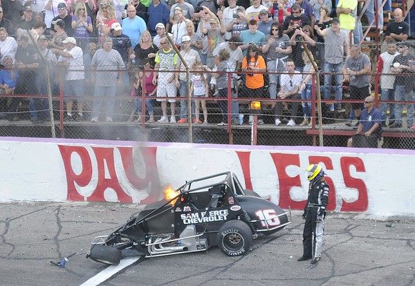 Don Knight | The Herald Bulletin<br /> Austin Nemire stands next to his car after an accident during the <br />  Little 500 on Saturday.