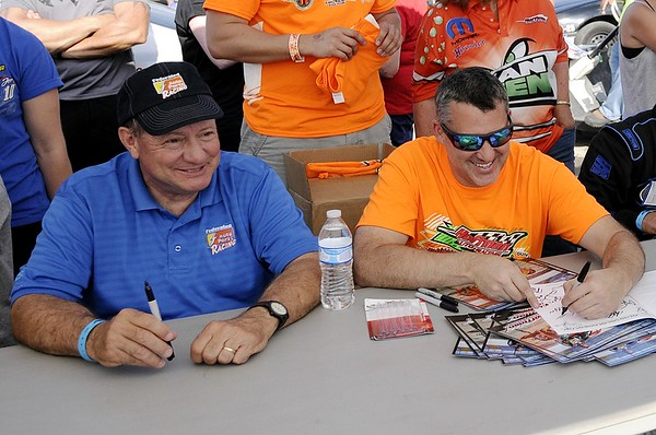 Don Knight | The Herald Bulletin<br /> Tony Stewart and Kenny Schrader sign autographs for fans during the Little 500 on Saturday.